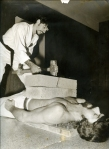 Student John Gordon breaks blocks while I lie on a bed of nails.